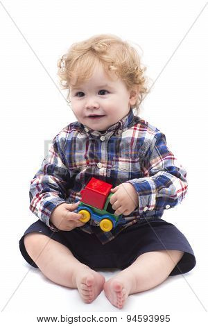Funny Baby Boy Playing With Car Toy