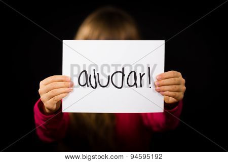 Child Holding Sign With Portuguese Word Ajudar - Help