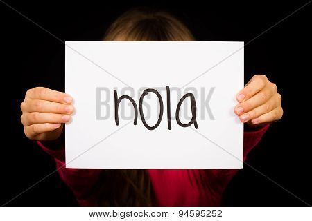 Child Holding Sign With Spanish Word Hola - Hello