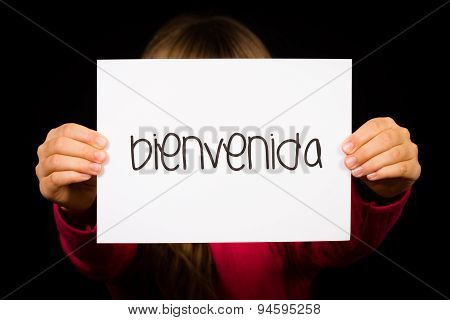 Child Holding Sign With Spanish Word Bienvenida - Welcome