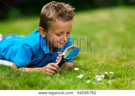 Boy With Loupe In Garden