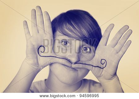 Instagram young girl with mustache drawn on hands silly face