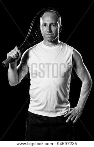 Adult male tennis player. Studio shot over black.