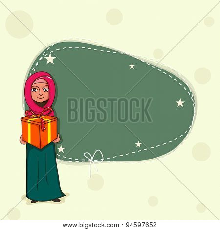Religious young Muslim lady in traditional dress, holding gift with blank frame for your message, Concept of celebrating Islamic holy festival, Eid.