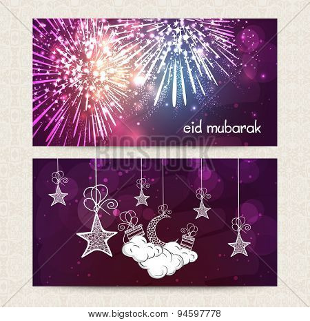 Beautiful fireworks, hanging moon and stars decorated web header or banner set for famous Islamic festival, Eid celebration.