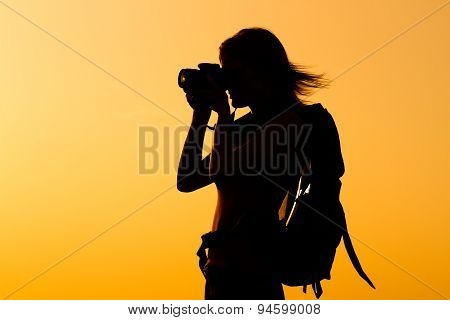 Woman hiker photographing