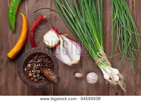 Fresh garden herbs and spices over wooden table. Top view