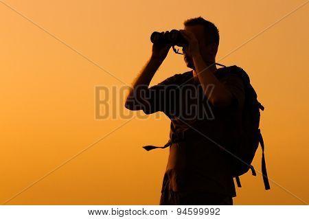 Hiker with binoculars