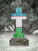 pic of cemetery  - Old weathered gravestone in the cemetery  - JPG