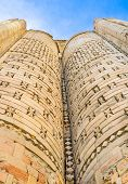 picture of zoroastrianism  - The relief brick walls with the interesting shaped details decorate the facade of Magoki - JPG