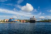 picture of curacao  - Cruise ship docked in the colorful port of Curacao on blue sea - JPG