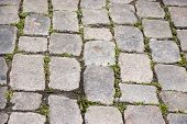 foto of cobblestone  - Old gray medieval weathered cobblestone road in the city - JPG