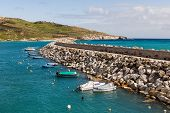 foto of gozo  - Entrance in bay seafront with lighthouse on seafront - JPG