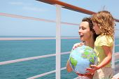 foto of cruise ship  - mother and daughter holding inflatable globe on cruise liner deck half body - JPG