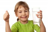 foto of drinking water  - small child drink water from glass container - JPG