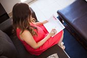 picture of pov  - Young pregnant brunette marking the baby - JPG