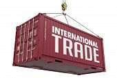 foto of hook  - International Trade concept with a Metal Shipping Container Suspended from a Crane Hook - JPG