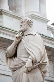 stock photo of vicenza  - The statue of the famous Italian architect of the Renaissance Andrea Palladio placed by the Basilica palladiana in Vicenza