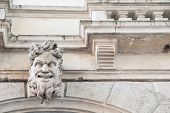 picture of vicenza  - White stone mascaron at the entrance of the baroque Leone Montanari palace 1678 in Vicenza - JPG