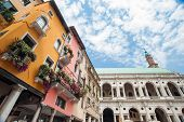 pic of vicenza  - The palladian Basilica and some colored palaces of the town center of Vicenza seen from Piazza delle Erbe  - JPG