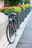 stock photo of vicenza  - Roadster bike parked by the railing of Saint Paul bridge in Vicenza - JPG