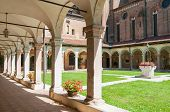 stock photo of vicenza  - The internal cloister of the gothic Saint Lorenzo church in Vicenza - JPG