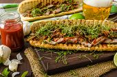 stock photo of cheese-steak  - Steak sandwich with herbs lime and microgreens with little bit kick of hot sriracha souce - JPG