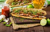 stock photo of cheesesteak  - Steak sandwich with herbs lime and microgreens with little bit kick of hot sriracha souce - JPG