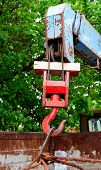 stock photo of hook  - red rusty old metal hook the manipulator - JPG