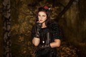 pic of gothic girl  - Portrait of a girl in a black dress of gothic stile with a clock on a chain - JPG