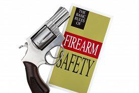 image of revolver  - Revolver Gun Pistol with Firearm Safety Brochure on White Background - JPG
