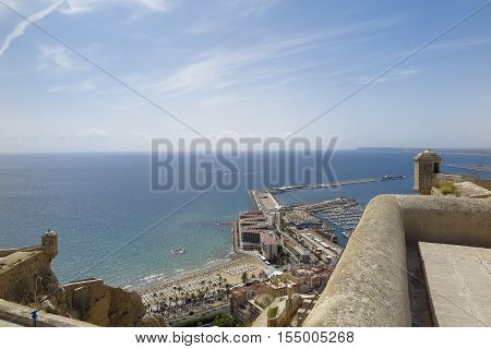 foreground of sentry boxes of the castle of santa barbara with harbour of alicante in the background