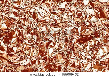 Shiny Foil Texture For Background And Shadow. Crease. Rose Gold Color. Red-brown Color