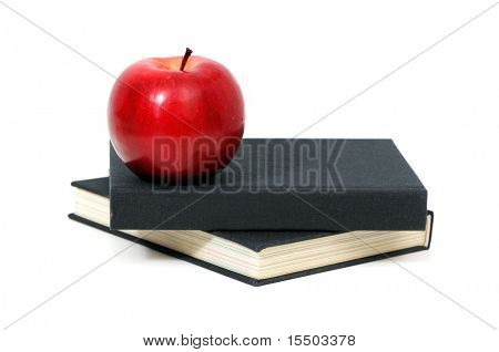 roter Apfel an einem Buch, isolated on white