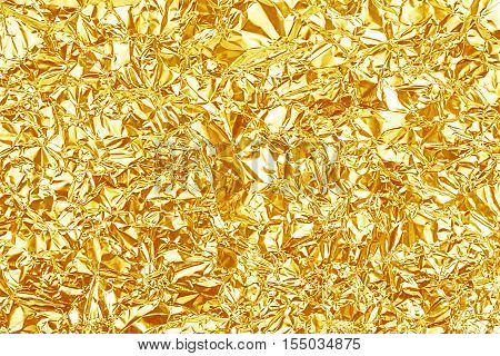 Shiny Yellow Gold Foil Texture For Background And Shadow. Crease