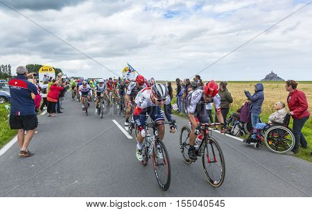 Ardevon France - July 2 2016: The peloton taking the start of Tour de France at Km 0 close to Mont Saint Michel Monastery in ArdevonFrance on July 22016.