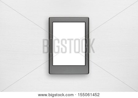 Electronic book mock up on white table