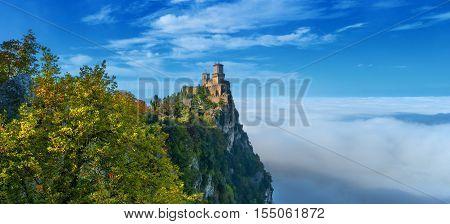 Rocca della Guaita, the most ancient fortress of San Marino, Italy. The fog at the bottom creates the illusion of clouds.