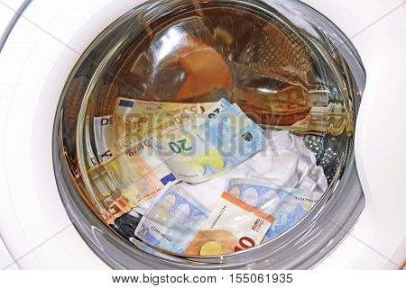 money laundering concept, euro bills fly in the washing machine