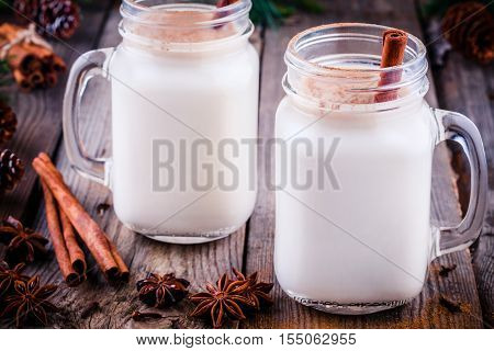 Christmas Drink: Eggnog With Cinnamon Stick In Mason Jars