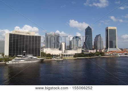 JACKSONVILLE, FLORIDA - OCTOBER 26, 2016: View of downtown Jacksonville with the super yacht Kismet on the left. Kismet is owned by billionaire Jacksonville Jaguars NFL team owner Shad Khan.
