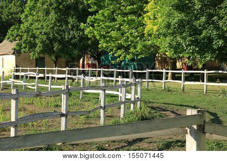 Village. Old fence. Old fence in village. Wooden fence