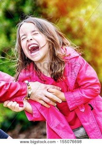 Happy Pretty Little Girl Playing With Her Mother