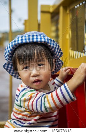 HAKONE, JAPAN - OCTOBER 4, 2016: Unidentified boy at Hakone sightseeing tour ship on lake Ashi in Japan. Hakone is one of the most popular destinations of Japanese and international tourists