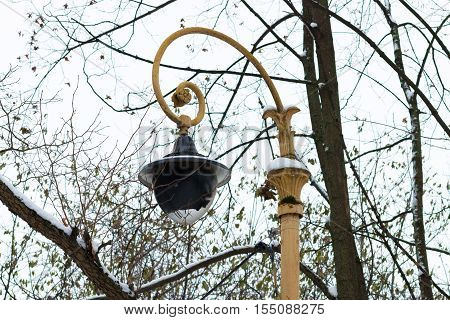 Vintage yellow lantern in park. Moscow Russia.