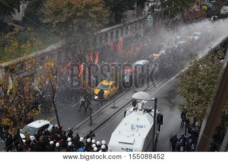 ISTANBUL,TURKEY-NOV 5 : Riot police use water cannons to disperse protesters during a protest against the arrest of pro-Kurdish Peoples' Democratic Party (HDP) lawmakers, in Istanbul, November 5, 2016