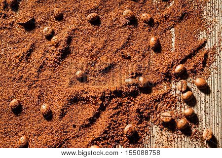 Coffe seed and grain as background on wooden table