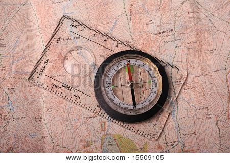 A Modern Compass Laid On A Map