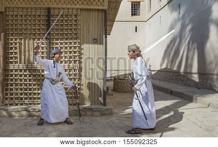 Young Omani Boy With A Sword