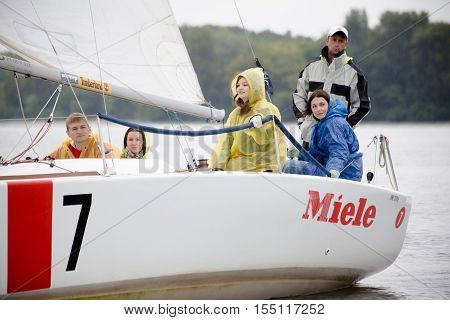 Kyiv Ukraine - August 122016:Sailing school in Kiyv Ukraine - August 2016 - Young people learning to sail in the harbor at Dniper river Ukraine before International Regatta Hetman Cup (ISAF Grade 2) run in Ukraine